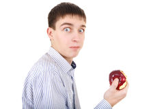 Surprised Teenager with an Apple. Isolated on the White Background Royalty Free Stock Photos