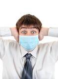 Surprised Teenager in Flu Mask Stock Image