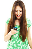 Surprised teenager girl looking on mobile phone Royalty Free Stock Photos