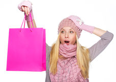 Surprised teenager girl in winter hat with shopping bag Royalty Free Stock Images