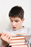 Surprised Teenager reads a Books Stock Image