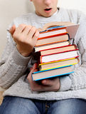 Surprised Teenager reads a Books Stock Photography