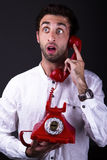 A surprised telephoneman. A man with an old phone talking surprised Stock Photography