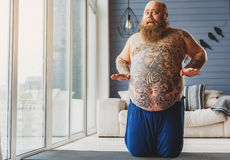 Surprised thick guy is satisfied with his workout Royalty Free Stock Images