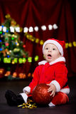 Surprised toddler with Christmas ball Stock Photos