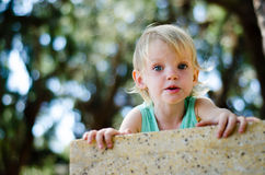 Surprised toddler girl looking right in camera shallow focus Royalty Free Stock Photos