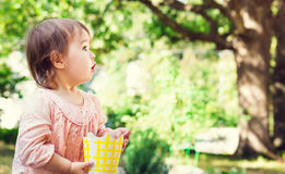 Surprised toddler girl playing outside Royalty Free Stock Photo