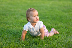 Surprised toddler is lying on the grass Stock Photography