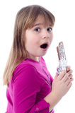Surprised under chocolate eating Royalty Free Stock Image