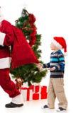 Surprised upset little boy watching Santa Clause leaving. Royalty Free Stock Photos