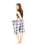 Surprised weight lost woman in too big pants Royalty Free Stock Photo