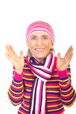 Surprised winter aged woman. In pink knitted clothes isolated on white background Royalty Free Stock Photo