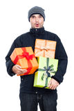 Surprised winter man with presents Stock Image