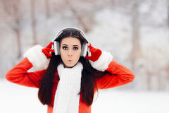 Surprised Winter Woman With Wireless Headphones Royalty Free Stock Photography
