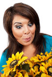 Surprised Woman. This young hispanic woman looks totally and completely surprised by this bouquet of sun flowers Royalty Free Stock Photo
