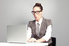 Surprised woman. Looking at her laptop Stock Image