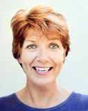Surprised Woman. Portrait of a surprised woman with yellow spot from the rightside, with copper color hair on white background stock photography