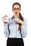 Surprised woman with an alarm clock in hands Stock Photography