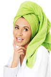 Surprised woman in bathrobe and towel on head Royalty Free Stock Image