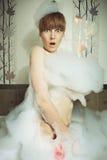 Surprised woman in bathroom Stock Image