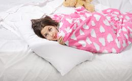 Surprised woman in bed Stock Image