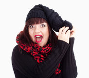 Surprised Woman in Black Cap and Red Scarf Royalty Free Stock Image