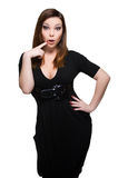 Surprised woman in black dress Royalty Free Stock Photography