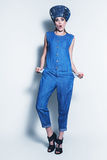 Surprised woman in blue denim jumpsuit Royalty Free Stock Photo