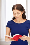 Surprised woman with book Stock Photos