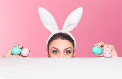 Surprised woman bunny over surface Royalty Free Stock Photo
