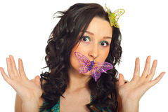 Surprised woman with butterfly Stock Image