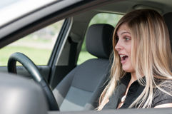 Surprised - woman in car Royalty Free Stock Photos
