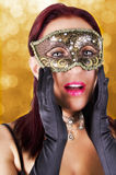 Surprised woman in carnival mask. Stock Image