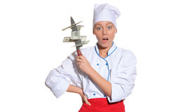 Surprised woman- chef with knife and money Stock Image