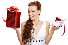 Surprised woman choosing presents Royalty Free Stock Image