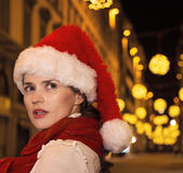 Surprised woman at Christmas in Florence, Italy looking aside. Trip full of inspiration at Christmas time in Florence. Closeup on surprised modern woman in Royalty Free Stock Photography