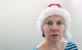 Surprised woman with Christmas Santa Claus hat in cheerful mood Royalty Free Stock Photos