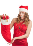 Surprised woman with Christmas socks Stock Photography