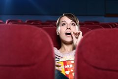 Surprised woman at the cinema Royalty Free Stock Images