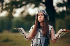Surprised Woman in Clear Transparent Raincoat in Summer Rain. Fashionable girl outdoors in nature in rainy weather Royalty Free Stock Photography