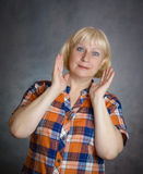 Surprised woman. Close-up portrait of surprised middle aged woman Royalty Free Stock Photography