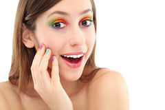 Surprised woman with colorful eyeshadow. Young woman over white background Stock Image