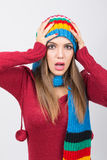 Surprised woman in colorful winter clothes Royalty Free Stock Images
