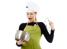 Surprised woman cook with stainless pot Stock Photos