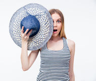Surprised woman covering her eye with hat Royalty Free Stock Images