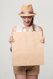 Surprised woman with craft shopping bag Royalty Free Stock Photo
