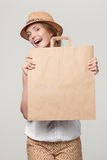 Surprised woman with craft shopping bag Stock Images