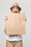Surprised woman with craft shopping bag Royalty Free Stock Photography