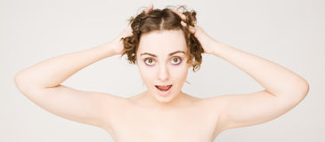 Surprised woman with curly hair Royalty Free Stock Photos