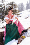 Surprised woman in the Dirndl Stock Photos